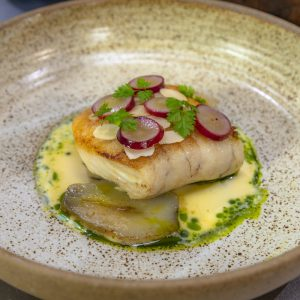 Pan Roast Hake, Confit Artichokes, Pickled Grape, Almond and Fennel Broth