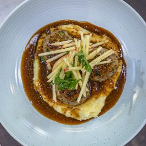 Pork Meatballs with mash, cider sauce and apples
