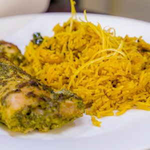 Hariyali Murgh and Peela Pulao (Lemon rice with cashew nuts)