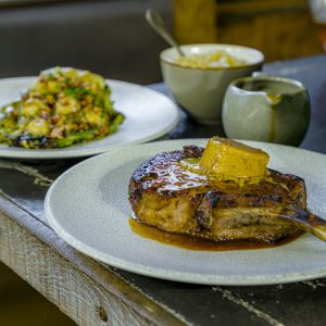 Saddleback Pork Chop, Café de Paris Butter, Roasted Spring Cabbage, Walnut Vinaigrette