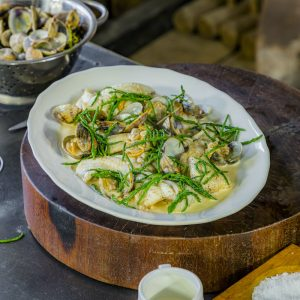 Pan fried fillets of dover sole with clams and samphire sauce
