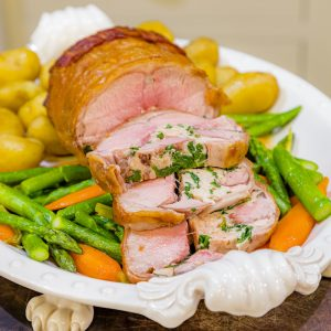 Stuffed Short Saddle of English Spring Lamb with Local Asparagus, Carrots, Jersey Royals