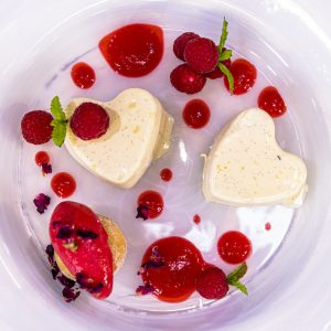 Panna cotta with raspberry compote and baby donuts