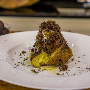 Baked Yukon Gold Potato, Oxtail Ragu, Sour Cream and Aged Parmesan