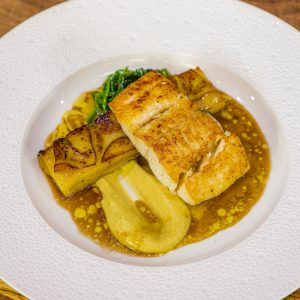 Seared Halibut Steaks, Boulangère Potatoes, Spiced cauliflower Puree and Thyme Jus