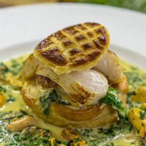 SCALLOPS IN A PUFF PASTRY WITH MUSSEL SAUCE AND SOUBISE BABY SPINACH