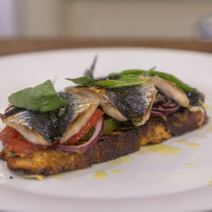 Baked Sardines with tomatoes on toast