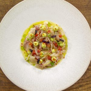 Sea bream ceviche with avocado vinaigrette, citrus vinaigrette and lime zest