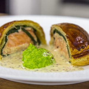 Salmon Pithivier with Pea Puree and Mustard Cream Sauce