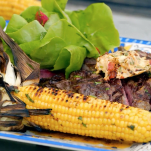 Rib-eye steak with chipotle butter, corn and bibb salad