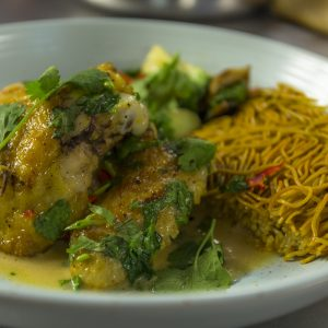 CHICKEN SAUTÉED WITH THAI SPICES & A CRISPY NOODLE CAKE